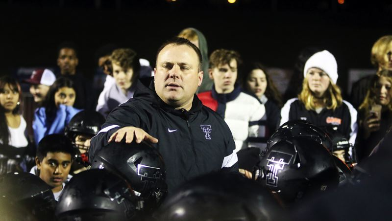 PMG PHOTO: DAN BROOD - Tualatin High School head football coach Dan Lever talks to Timberwolf players and fans following the team's 50-35 state playoff win over North Medford on Friday.