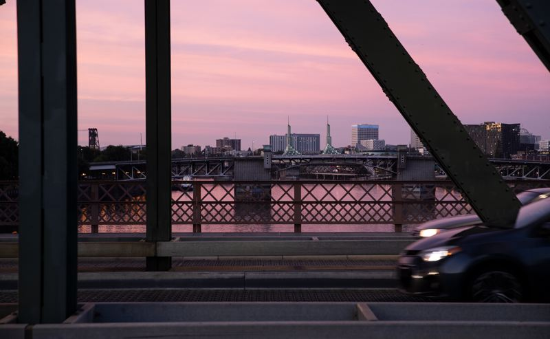 MULTNOMAH COUNTY/MOTOYA NAKAMURA - The Oregon Convention Center can be seen from the Hawthorne Bridge in Portland during a purple-hued sunset in September, 2019.