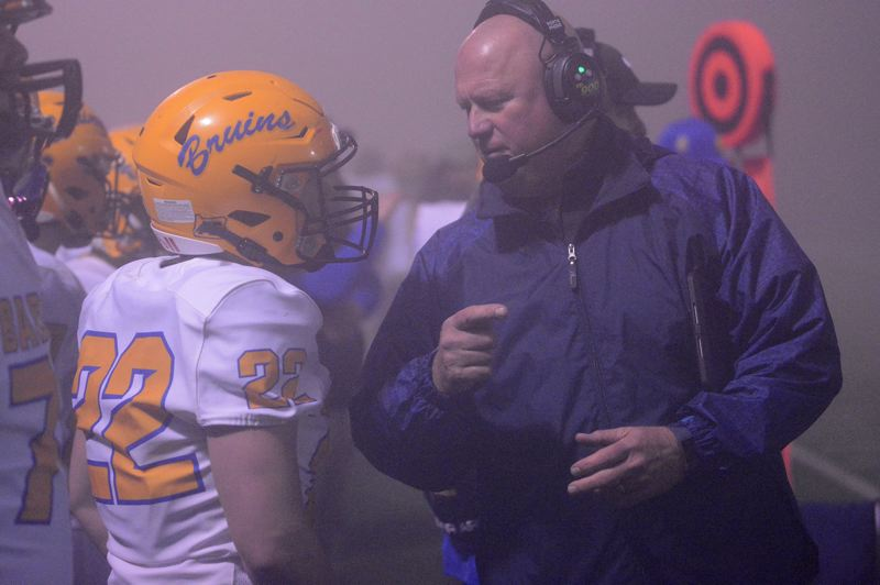PMG PHOTO: DAVID BALL - Barlow head coach Terry Summerfield visits with linebacker Hunter MacDonald along the sideline.