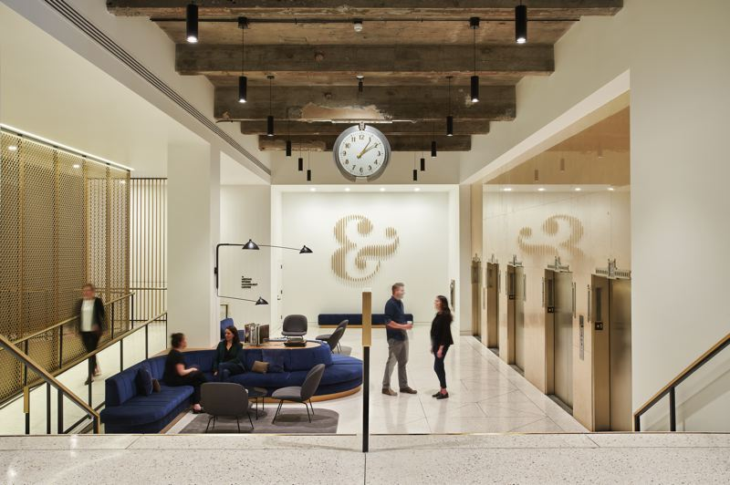 COURTESY: BORA ARCHITECTURE - The Meier & Frank Building lobby design recently won two 2019 International Interior Design Association Oregon Design Excellence Awards. Features include the ramp screen, the art deco clock, the 45 foot sofa and the uncovered stone around the elevators.