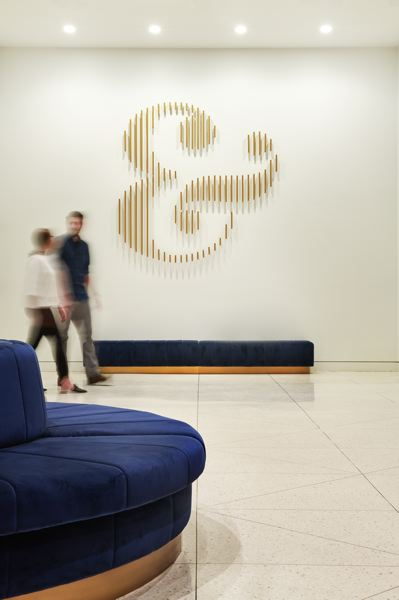 COURTESY: BORA ARCHITECTURE - The Meier & Frank lobby remodel included a 45-foot custom made sofa designed for office workers and the general public to relax on in the former department store, which is now an office building. The ampersand sculpture was abstracted from the logo redesign by the building's owner in Chicago.
