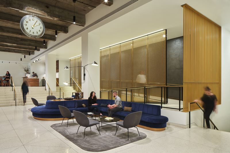 COURTESY: BORA ARCHITECTURE - The Meier & Frank Building lobby design recently won two 2019 International Interior Design Association Oregon Design Excellence Awards. Features include the ramp and screen, the art deco clock, the 45 foot sofa and the uncovered stone around the elevators.