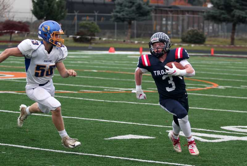 PMG PHOTO: PHIL HAWKINS - Kennedy senior Bruce Beyer had a strong all-around day, rushing for a game-high 102 yards and two touchdowns to go along with a 57-yard fumble return for score, four PATs, a two-point conversion pass and a 22-yard field goal.