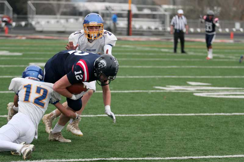PMG PHOTO: PHIL HAWKINS - Traeger led the Trojans with a game-high five catches for 48 yards and a score. Teammate Dylan Kleinschmit completed 9-of-12 passes for 103 yards and three touchdowns.