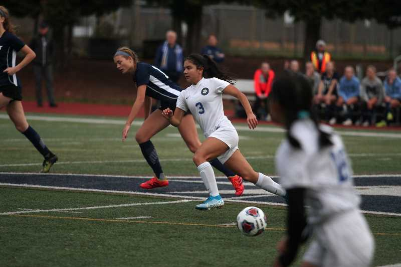 PMG PHOTO: PHIL HAWKINS - Woodburn junior Yahaira Rodriguez sprints ahead to get into position in the opening 10 minutes of the contest. Moments later, Rodriguez collected a pass from teammate Myranda Marquez and punched it past the Marist goalkeeper for the game-winning score in the 8th minute.