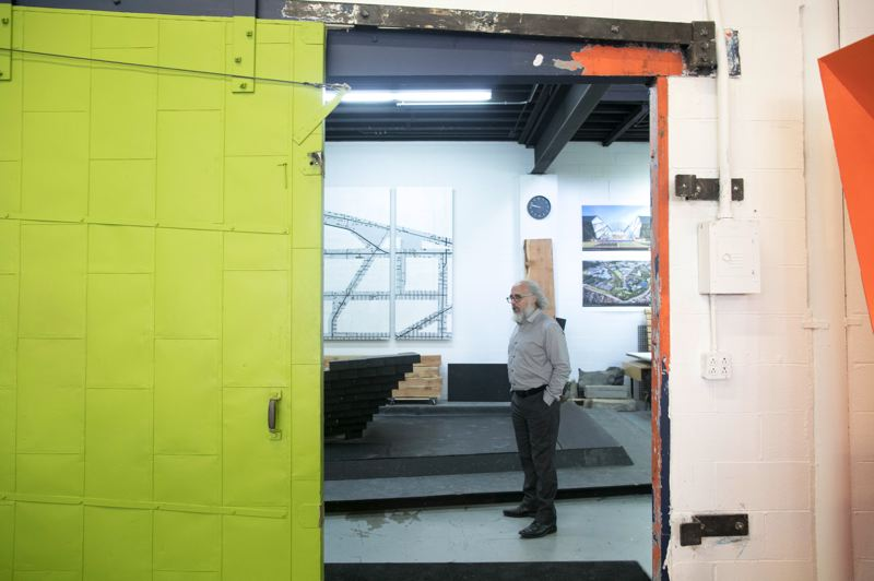 PMG PHOTO: JAIME VALDEZ - Mauricio Villarreal, one of four original founders of PLACE, stands in the workshop in the firm's Portland studio in Northwest Portland.