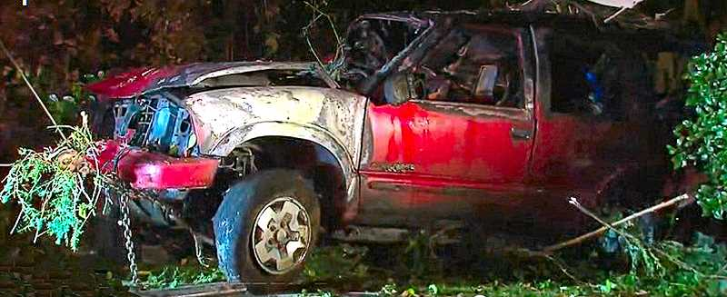 COURTESY KOIN-6 NEWS - This smashed and burned SUV is what remains after a drivers failed attempt to flee the police on Harney Drive.