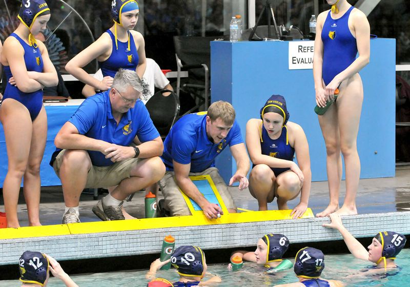 PMG PHOTO: GARY ALLEN - Barlow High coach Mike Riegelmann addresses his team during a timeout in Saturdays 10-3 loss to Newberg in the girls water polo title game.