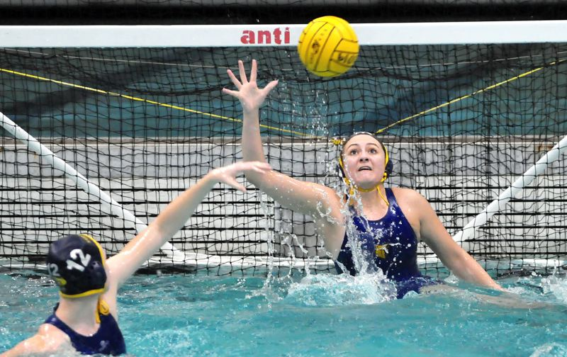 PMG PHOTO: GARY ALLEN - Barlow's Emma Strobel rises out of the water to keep a ball out of the Bruins cage.