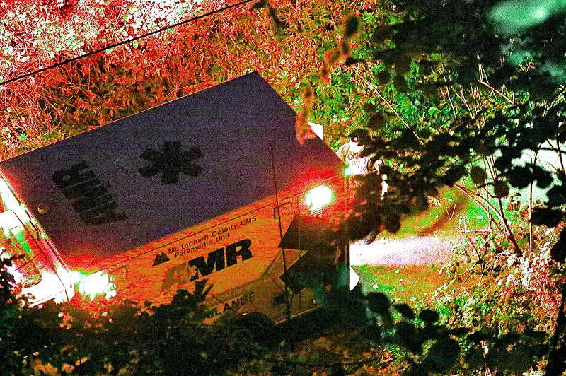 DAVID F. ASHTON - After retrieving a fall victim who apparently survived a five-story drop from a viaduct above, an AMR ambulance prepares to return down the Springwater Corridor Trail in Ardenwald, east of McLoughlin Boulevard.