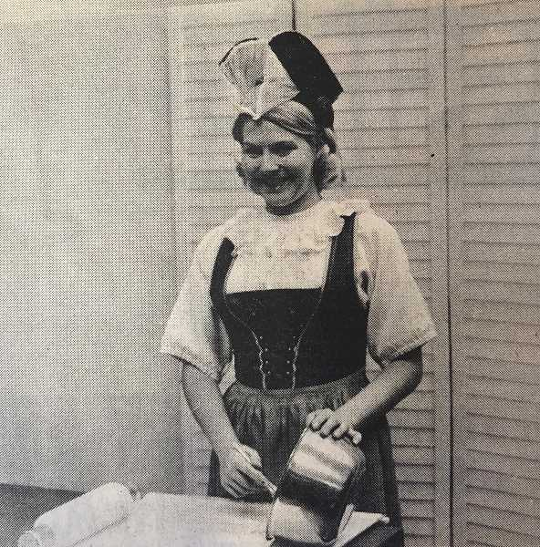 "CENTRAL OREGONIAN - NOVEMBER 20, 1969: Miss Joyce Herold, Crook County Extension Agent, demonstrates how to make Danish pastry at the ""Holiday Fare"" program sponsored by Central Oregon Home Extension agents. The theme of the program was ""International Flair,"" which was carried out with demonstrations. Joyce was dressed in a costume from the Appenzell district of Switzerland."