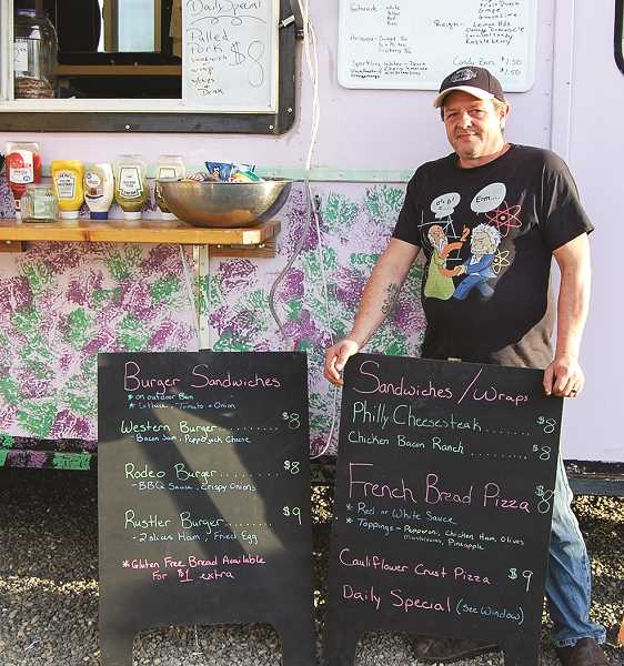 RAMONA MCCALLISTER - Darren Hepperle stands by his food truck, Jessicas Kitchen. He and his wife, Jessica, offer a wide variety of specialty sandwiches and burgers.