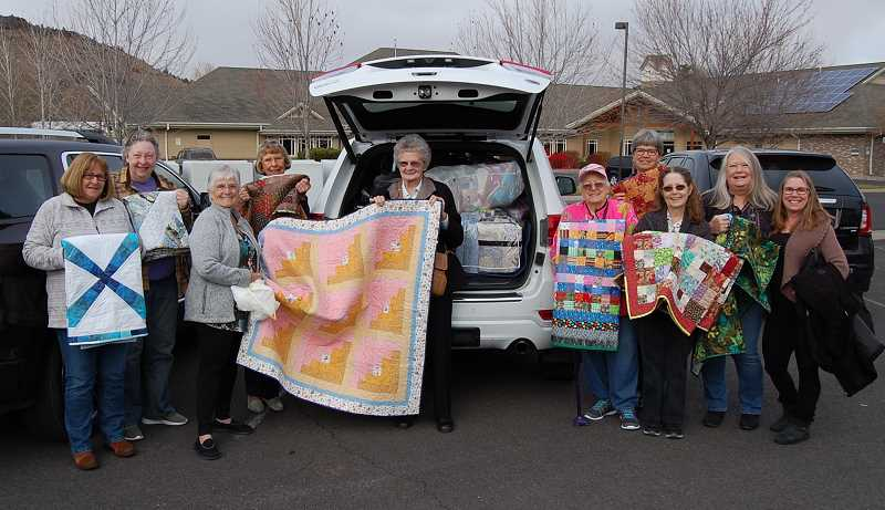 RAMONA MCCALLISTER - The Crook County Quilters that delivered the quilts to St. Charles Cancer Center for 2019: From Left: Susie Morales, Bonnie Laudrow, Marilyn Malloy, Elva Crafton, Janice Putana, Dorothy Nissom, Becky Glover (back), Mona Case, Sondra Craig and Nora Morris.