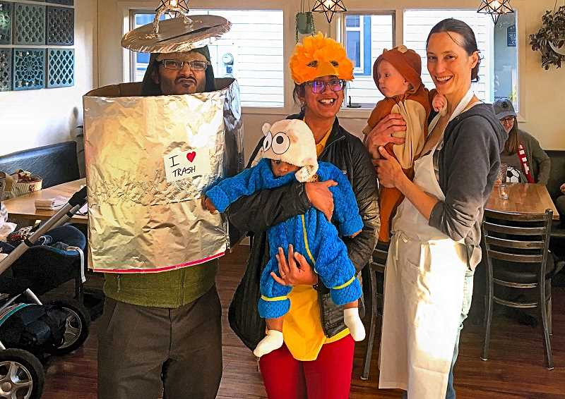 Winner of Westmorelands Communion Bakehouses Baby Costume Contest on Halloween was baby Rahil, as the Cookie Monster - accompanied by parents Oscar the Grouch and Big Bird. Presenting the prize was Pastry Chef, and Co-Owner of Communion Bakehouse, Kat Zacher, with her own baby, Lazlo.