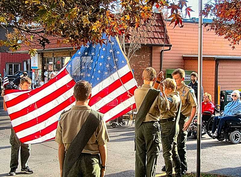 ERIC NORBERG - Boy Scout Troop 64 prepares to raise Elmcroft Senior Livings new American Flag in a ceremony that was part of a Veterans Day observance.