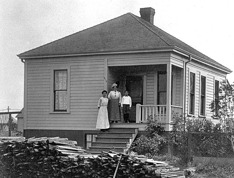 COURTESY SMILE HISTORY COMMITTEE - This house, at an unknown Sellwood address, was photographed in 1909. This historic image shows a different structure of the same age, and almost identical construction, to the Vollum home - which over time acquired replacement windows, porch pillars, wide plank siding, and possibly the fireplace.