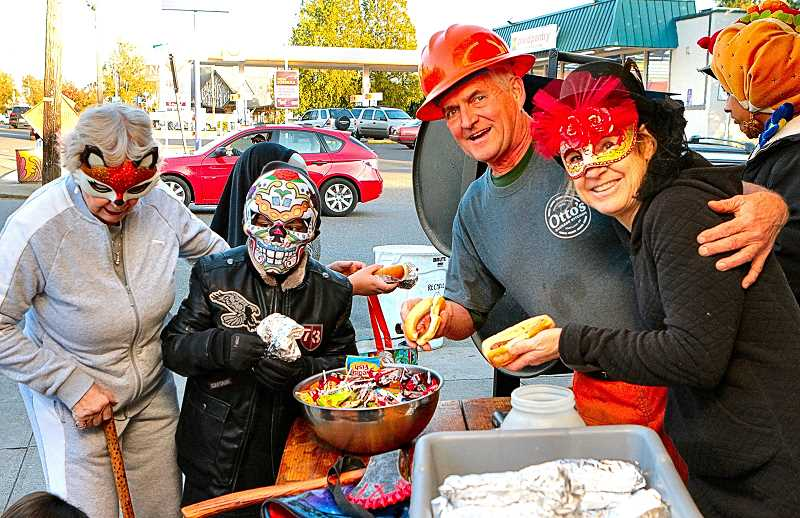 DAVID F. ASHTON - Ottos Sausage Kitchens owners, Jerry and Gretchen Eichentopf, asked Trick or Treaters, Hot wienies for Halloween - or candy?  Most took both!