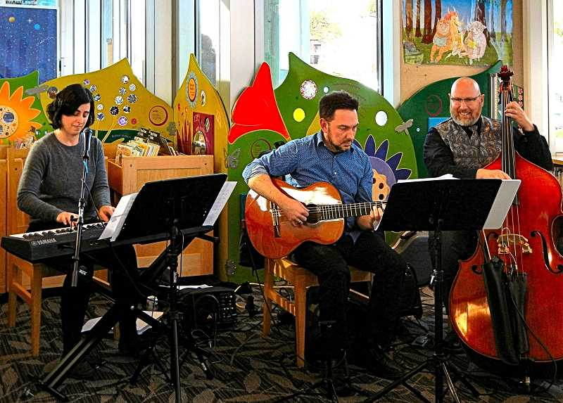 ELIZABETH USSHER GROFF - Kerry Politizer, Ben Graves, and Bernardo Gomez (shown left to right), recently performed Bossa Nova and Brazilian jazz in the Woodstock Branch Library, S.E. 49th at Woodstock Boulevard.