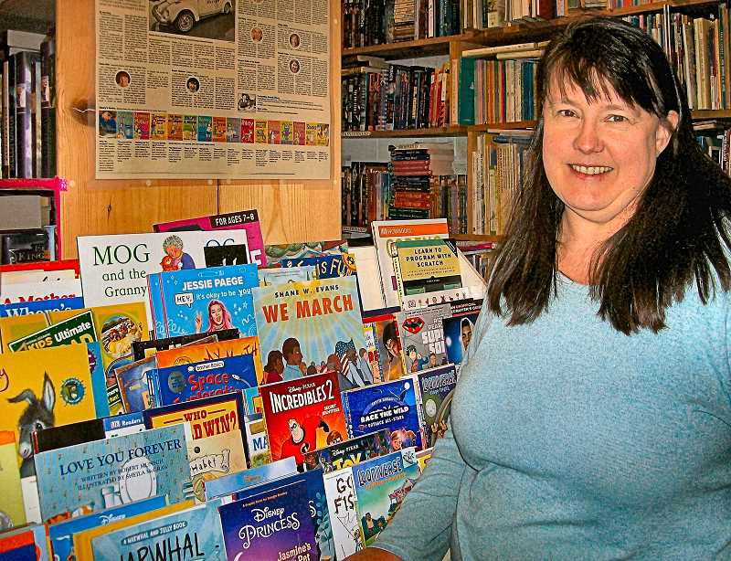 RITA A. LEONARD - Julie Wallace is the person behind Westmorelands renowned used-and-new book store for readers of all ages, Wallace Books. Here, she stands by some of her kids books.