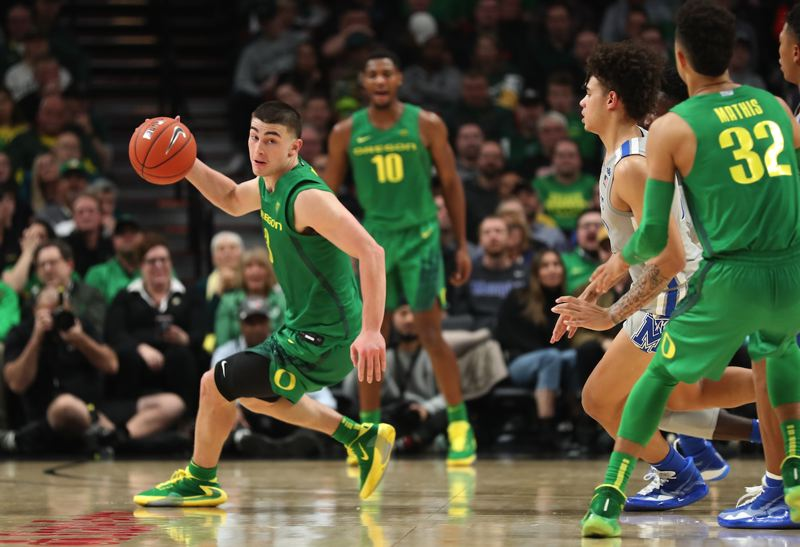 PMG PHOTO: JAIME VALDEZ - Oregon guard Payton Pritchard works the dribble against Memphis as another former West Linn High standout, Anthony Mathis, tries to set a screen.