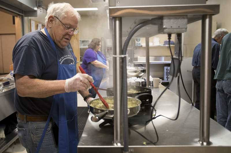 PMG FILE PHOTO - Ray Klupenger, a parishioner of St Cyril's Catholic Church since 1963, cooked stuffing in preparation for the 2018 Thanksgiving meal.