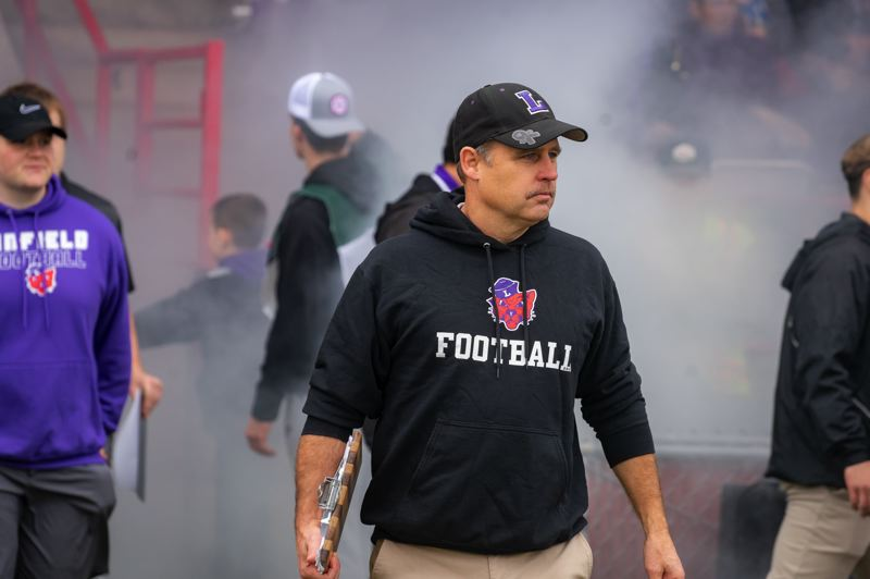 COURTESY PHOTO: LINFIELD COLLEGE/LIAM PICKHARDT - Linfield is back in the national football playoffs under coach Joseph Smith and in part due to the exploits of sons Colton and Wyatt.
