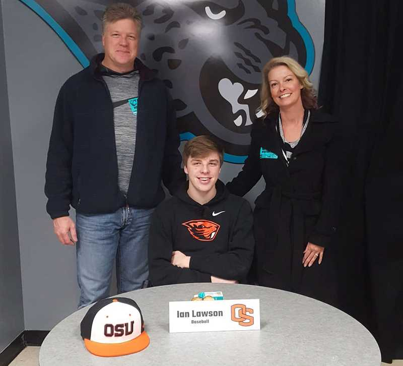 COURTESY PHOTO - Century's Ian Lawson poses for a photo with his parents during a signing ceremony with friends and administrators Wednesday, Nov. 13, at Century High School.