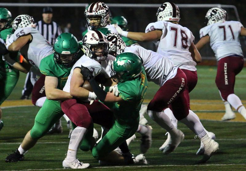 PMG PHOTO: BRIAN MONIHAN - The West Linn defense stepped up big-time on Friday, Nov. 15, shutting out Sherwood for the first 34:38 of its 35-14 win in the second round of the Class 6A state playoffs at West Linn High School.
