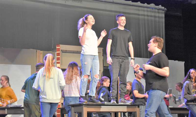 PMG PHOTO: EMILY LINDSTRAND - Students sing during biology class in Estacada High School's production of 'Freaky Friday.'