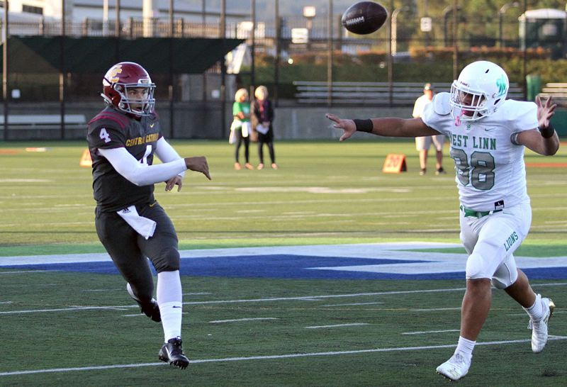 PMG PHOTO: MILES VANCE - Central Catholic quarterback Cade Knighton (left) and West Linn defensive end Damiko Tidmore (shown here in 2018) will battle again at 7 p.m. Friday, Nov. 22, at Hillsboro Stadium.