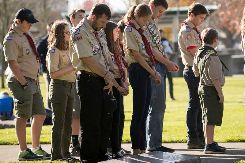 PMG PHOTO: JAIME VALDEZ - Members of Troop 194 participate in Veterans Day Commemoration at the Oregon Korean War Memorial at the Town Center Park in Wilsonville.