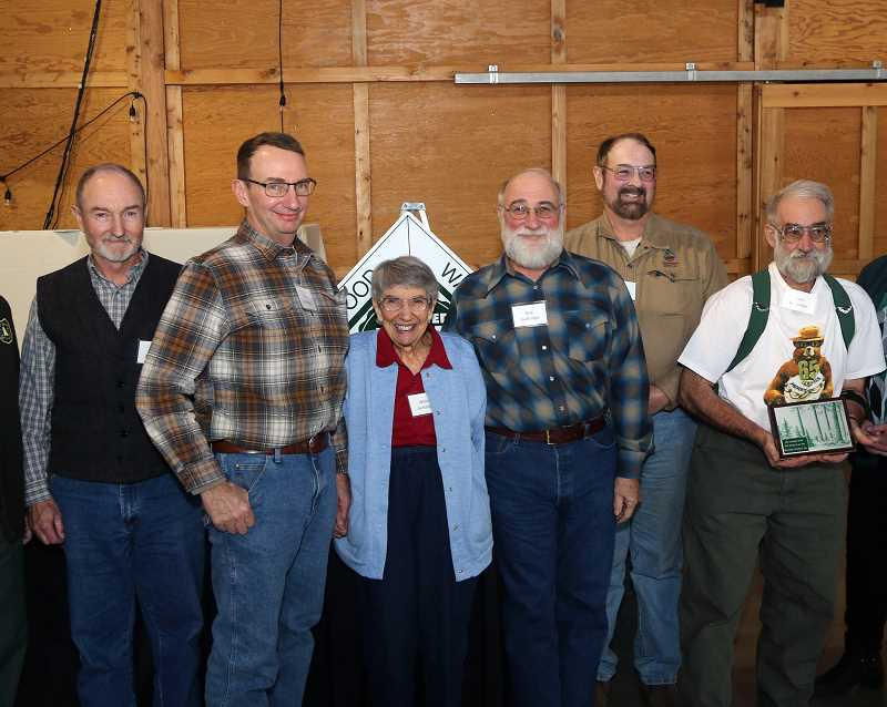 COURTESY PHOTO - Alan, Tim, Wilma, Rob, Don and Gary Guttridge were honored during the Oregon Tree Farm System's annual awards luncheon.
