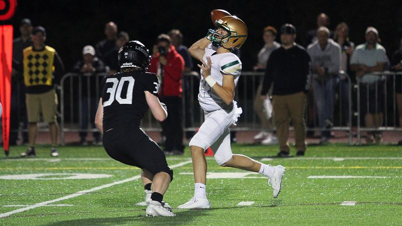 PMG PHOTO: MILES VANCE - Jesuit High School junior quarterback Jack Heyden (right) has passed for 1,323 yards and16 touchdowns going into Friday's Class 6A state playoff quarterfinal game with Tualatin.