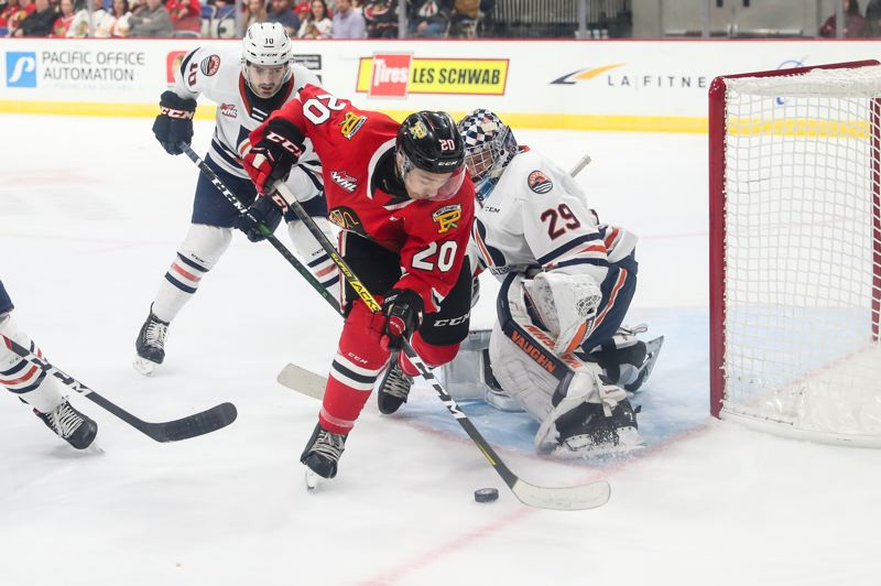 COURTESY PHOTO: KEITH DWIGGINS - Kishaun Gervais of the Portland Winterhawks works with the puck near the net against Kamloops.