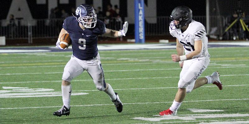 PMG PHOTO: MILES VANCE - Lake Oswego senior Casey Filkins (shown here against Tualatin) rushed for five touchdowns and threw another in his team's 42-31 win over West Salem at Lake Oswego High School on Friday, Nov. 15.