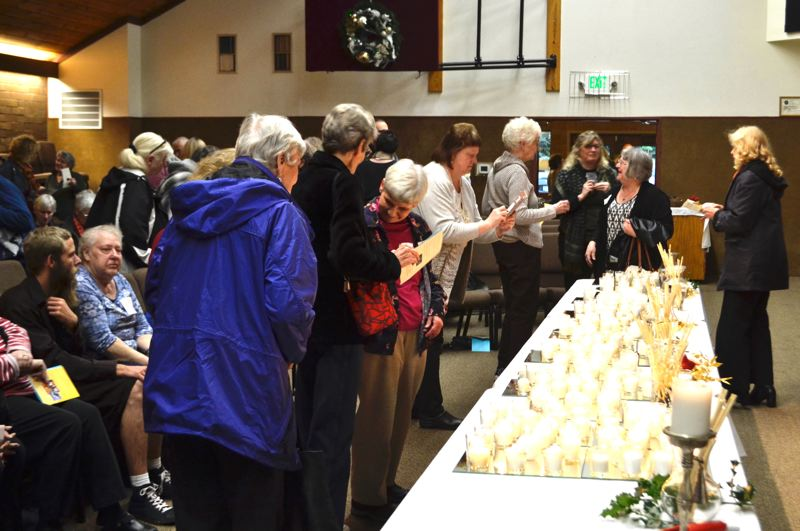 PMG FILE PHOTO - The Time of Remembering on Dec. 7 will feature music by harpist from Sacred Flight, a reading of names, the lighting of candles and a memorial video.