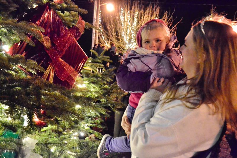 PMG FILE PHOTO - Community members of all ages are invited to enjoy cocoa, cookies and more at the annual tree lighting in Sandy on Dec. 6.