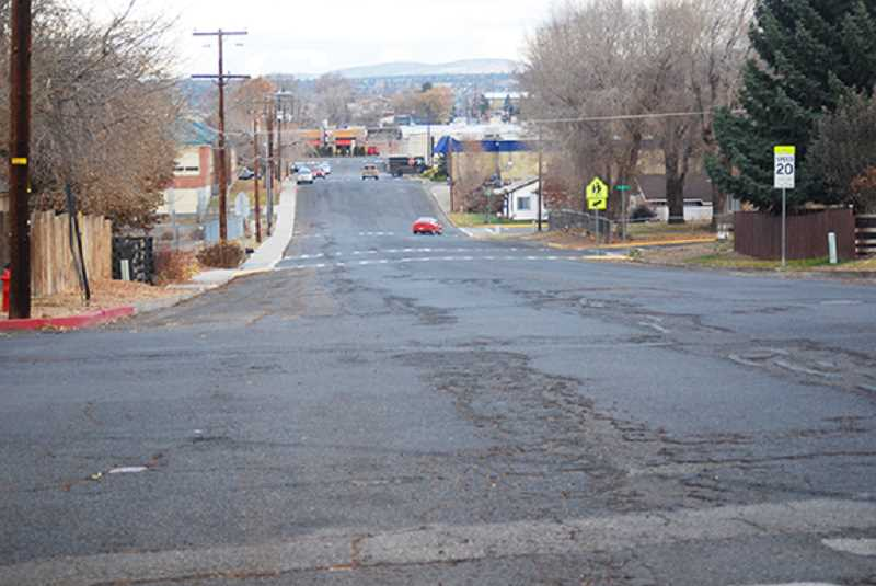 TERESA JACKSON/MADRAS PIONEER - G Street between Fourth Street and Culver Highway is an example of the $14 million backlog the city of Madras has in road repairs.
