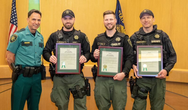 COURTEST PHOTO: MCSO - Multnomah County Sheriff Michael Reese, left, presents awards to Deputies Nick Bohrer, Jackson Brooks and Kent Krumpschmidt, for excellence in the performance of their duties.