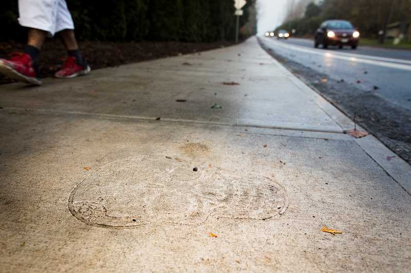 PMG PHOTO: JAIME VALDEZ - One of four designs permanently imprinted on Sagert Street in Tualatin. The design is part of the city's community art project.