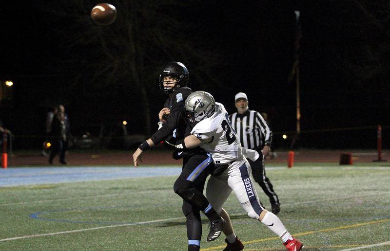 PMG PHOTO: MILES VANCE - Lakeridge senior quarterback Cooper Justice and Lake Oswego freshman linebacker Zach Mahan may be seeing each other again at 7 p.m. Friday, Nov. 22, when the Lakers host the Pacers in the Class 6A state quarterfinals.