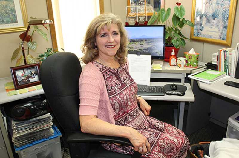 SUSAN MATHENY/FOR THE PIONEER - Holly Gill, the Madras Pioneer's managing editor, will retire at the end of November. A reception for Gill will be held from 2 to 4 p.m. Friday, Nov. 22.