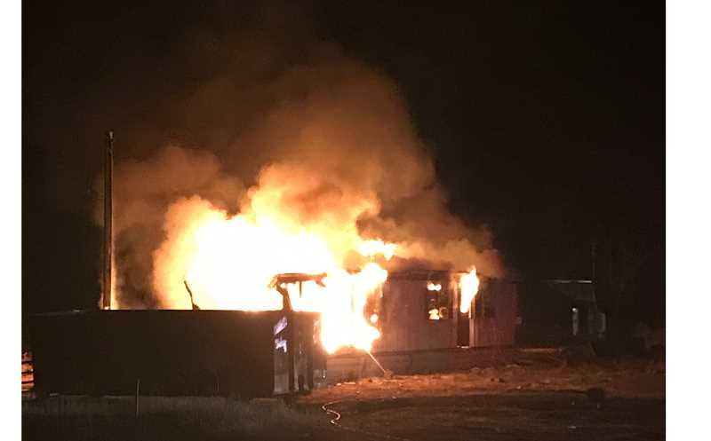 SUBMITTED PHOTO - A vacant mobile home on Northwest Columbia Drive went up in flames Sunday night. The cause of the fire, which destroyed the structure, is under investigation.