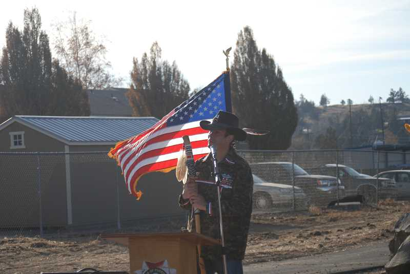 TERESA JACKSON/MADRAS PIONEER - Johnathan Courtney speaks words of dedication at the Veterans Healing Memorial. The memorial is designed to help prevent veteran suicides, work Courtney is active in.