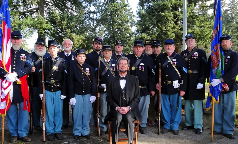 COURTESY PHOTO - Sons of Veterans dressed as Col. Edward D. Baker's 71st Pennsylvania Infantry join Steven Holgate as President Abraham Lincoln in Oregon City.
