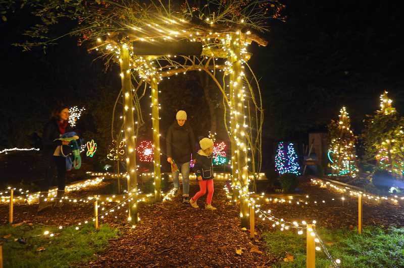 PMG PHOTO: JAIME VALDEZ - Families attend the Lighting of Maddax Woods event in West Linn.