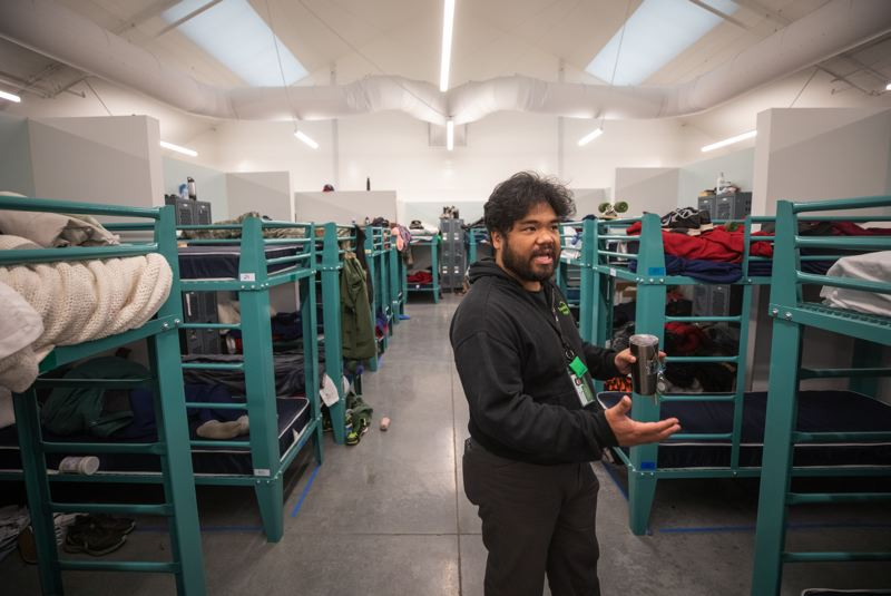PMG PHOTO: JONATHAN HOUSE - Paul Susi, Transition Projects staffer and manager of the River District Navigation Center, shows off some of the 100 heavy, steel bunk beds which are available for homeless people for up to 90 days.