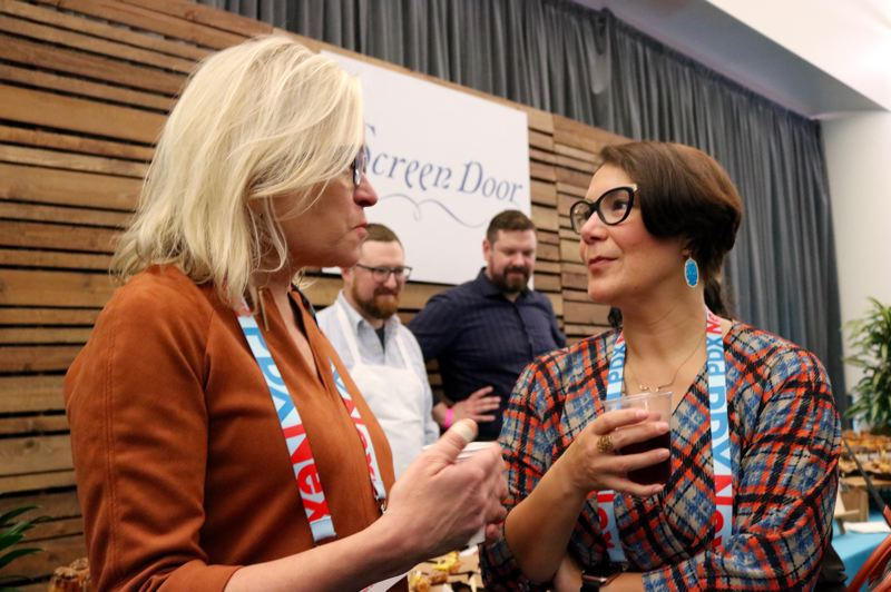 PMG PHOTO: ZANE SPARLING - Multnomah County Commissioner Jessica Vega Pederson, right, chats with Business for a Better Portland Executive Director Ashley Henry at PDX on Tuesday, Nov. 19.