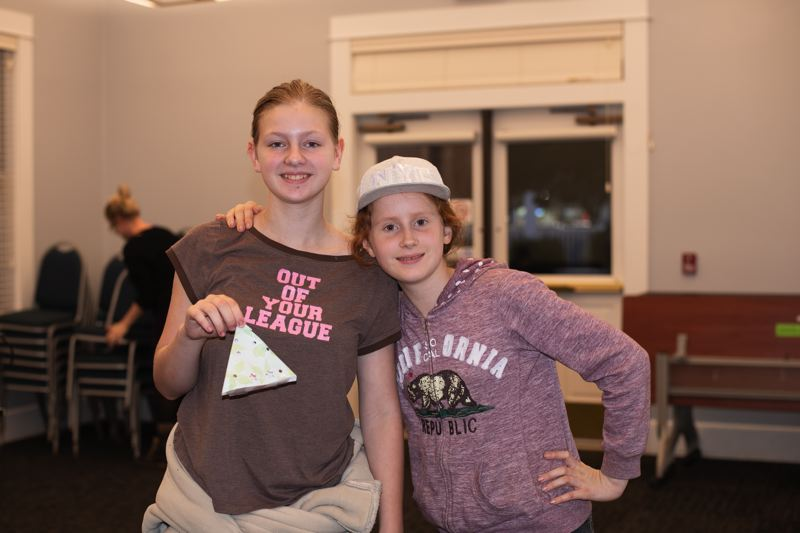 PMG PHOTO: ANNA DEL SAVIO - Hanna Tews and Lauren Ball attend a Teen Anime event at the library in November.