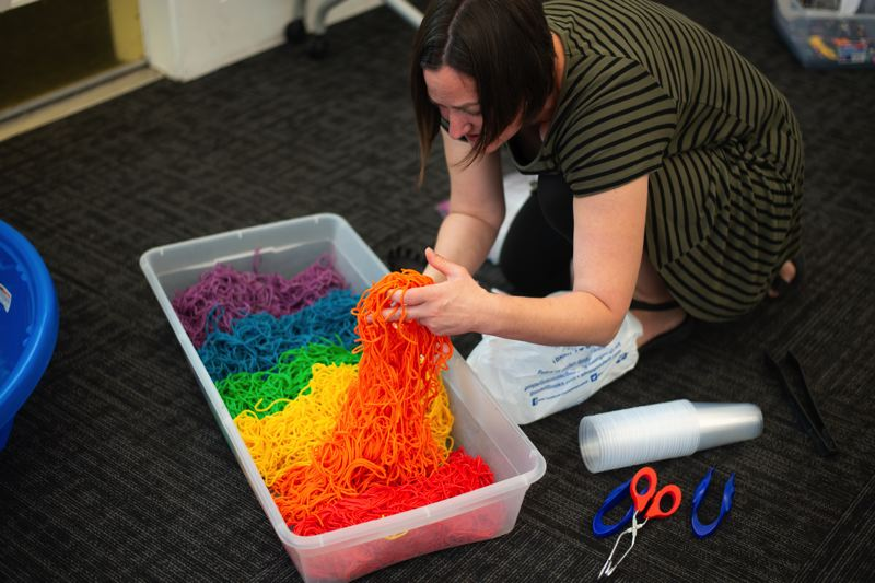 PMG PHOTO: ANNA DEL SAVIO - Librarian Wendi Andrews prepares colorful spaghetti for a childrens event focused on sensory play.